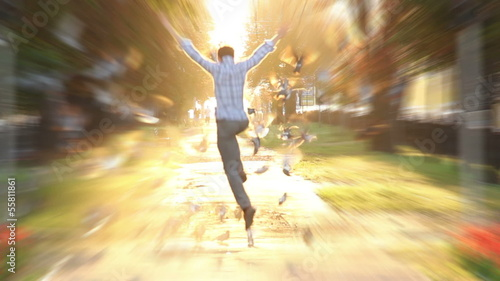 Man jumps high super slow motion shot heaven sun light