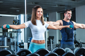 Young beautiful girl exercise with personal trainer