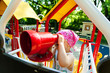 little girl looking through telescope on a play ground