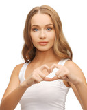 woman showing heart shape