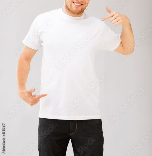 man pointing at blank white t-shir
