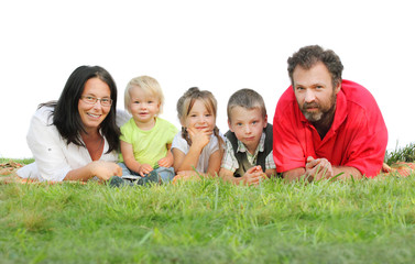 Happy family on the grass isolated on a white background.