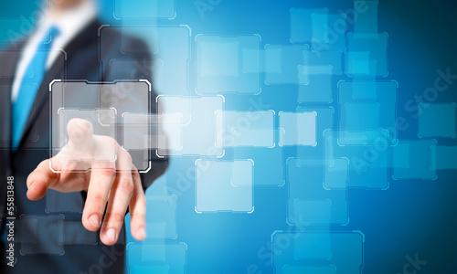 Businessman touching icon