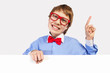 Boy in red glasses holding white square