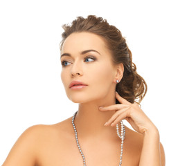 woman with pearl earrings and necklace