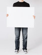 man showing white blank board