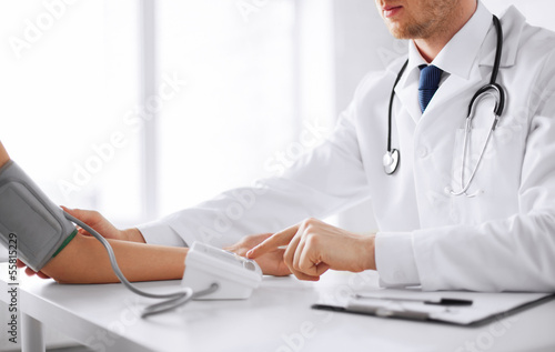 doctor and patient measuring blood pressure