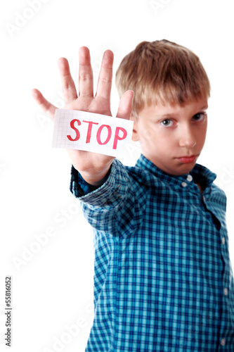 "Beautiful boy shows a message ""Stop"" looking upset"