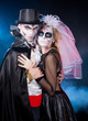 man and woman  wearing  as  vampire and witch. Halloween