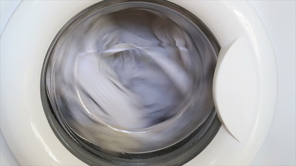 Washing machine works, washes clothes and squeezes