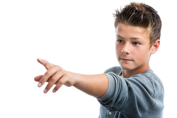 Cute boy pointing into the distance with finger.