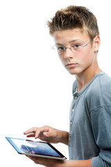 Young student standing with tablet.