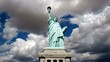 Statue of Liberty wide shot with moving cloud time lapse.