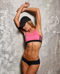 Sporty woman in pink top with beautiful body