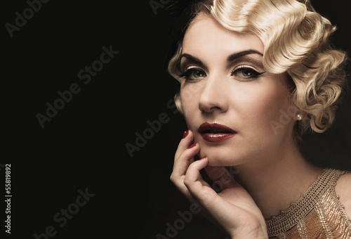Elegant blond retro woman  in golden dress