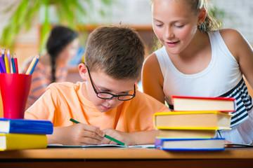 Schoolchildren in classroom at school