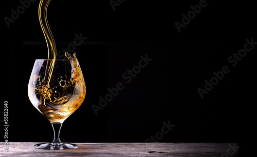 Cognac or brandy on a wooden table - 55822640