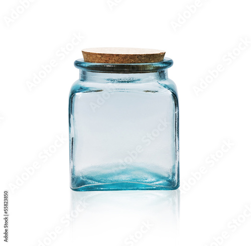 Empty glass jar with cork stopper isolated on white.
