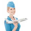 Charming Stewardess Holding Airplane In Hand. Isolated On White