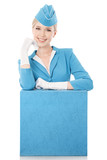 Charming Stewardess Dressed In Blue Uniform And Suitcase On Whit
