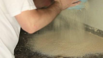 Flour being sieved