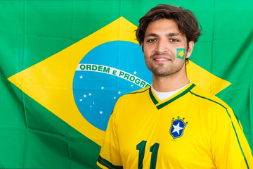 Confident Brazilian Supporter Standing in front of Brazilian Fla