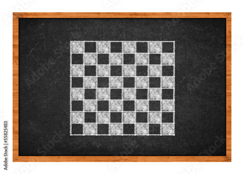 Chess board drawing on a black chalkboard