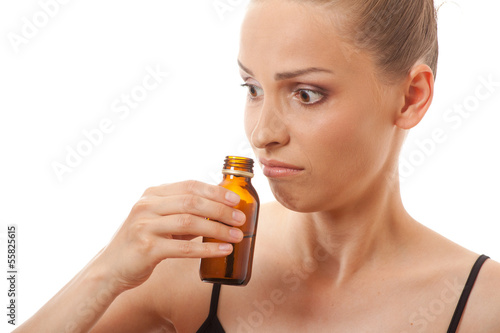 woman smelling bottle