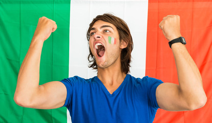 Successful Sportsman Shouting in front of Italian Flag