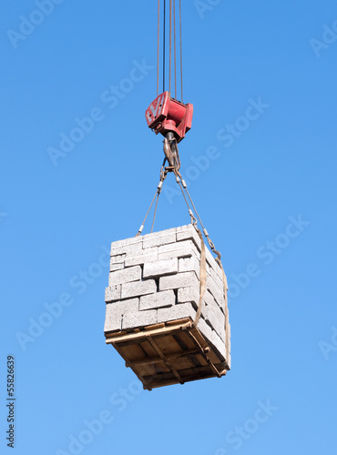 Cargo lifting against the blue sky