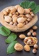 Hazelnuts, walnuts and almonds with leaves