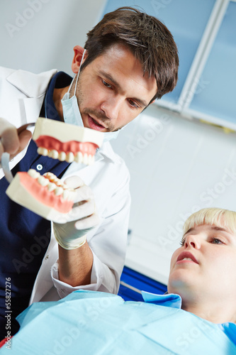 Dentist explaing denture to patient