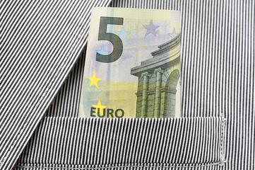 money in pocket of suit
