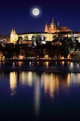 Night Prague gothic Castle with the Moon Czech Republic