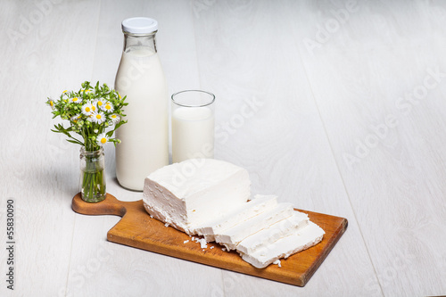 milk bottle and glass on wooden background