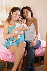 latin mom and sister with cute baby