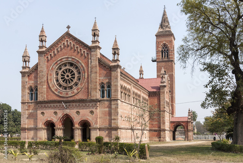 India Kanpur: All Souls Church in its park with tower and rose-w