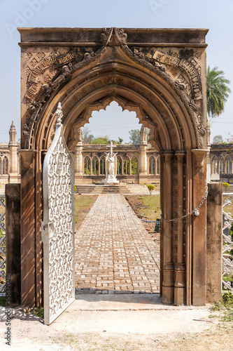India Kanpur: view through decorated arch upon statue of angel o