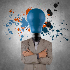 businessman with lamp-head and splash colors