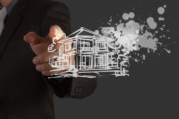 businessman hand draw house and splashing  color