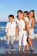 Children are standing on beach