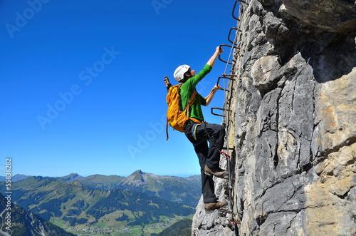 canvas print picture Kletterer am Klettersteig