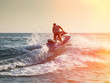 Silhouette of man on jetski at sea - 55836609