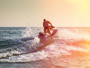 Silhouette of man on jetski at sea