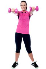 Happy gym woman lifting dumbbells