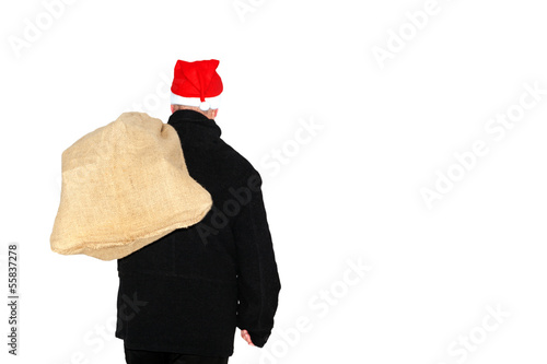 Man with cloth bag runs through the snow