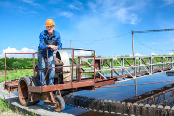Service staff of water treatment plant on the work