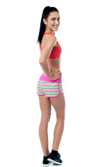 Young slim fit woman posing in style