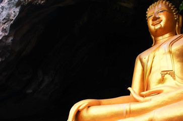 Beautiful golden Buddha statue located on a high mountain