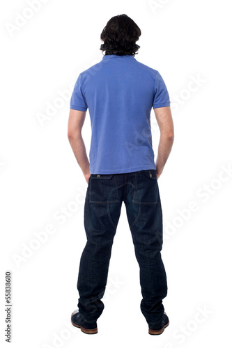 Casual young man facing the wall